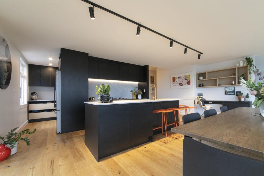 black kitchen with b;ack downlights